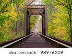 Railroad Tracks Lead Through A...
