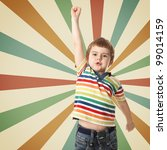 Cheerful little boy raised his hand up. Shooting in the studio - stock photo