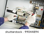 closeup hands of electrician... | Shutterstock . vector #99044894