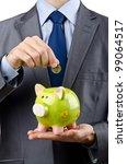 man saving his money in the... | Shutterstock . vector #99064517