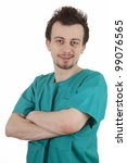 smiling male doctor in green workwear with crossed arms, white background - stock photo