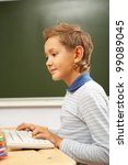 portrait of cute lad typing on... | Shutterstock . vector #99089045