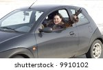 signing woman driving her car - stock photo