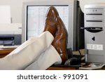An Office Worker Puts His Feet...
