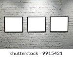 Black Frames On White Brick...
