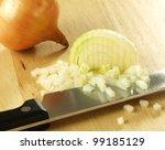 Chopped Onion On Cutting Board