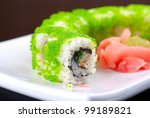 Sushi rolls made of salmon, avocado, flying fish roe - stock photo