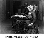 Elderly man in wheelchair - stock photo
