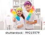 Dust cleaning taskforce - boy and girl with duster brushes - stock photo