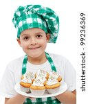 Happy smiling chef boy with a plate of muffins - isolated - stock photo