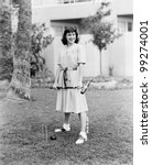 Woman Playing Croquet In The...