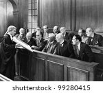 Lawyer showing  evidence to the jury - stock photo