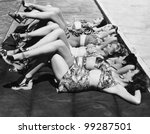Group of women relaxing in a row together - stock photo