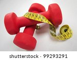 Dumbbell and measuring tape/isolated on white - stock photo