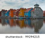Wooden houses in many color on the waterfront - stock photo