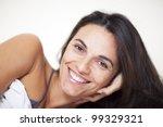 latin female model lying in bed | Shutterstock . vector #99329321