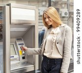 young woman using bank atm... | Shutterstock . vector #99409289