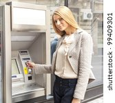 young woman using bank atm... | Shutterstock . vector #99409301