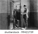 Policeman And Prisoner In A...