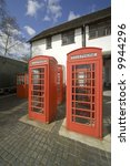 four red telephone boxes in an... | Shutterstock . vector #9944296