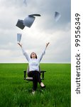 smiley businesswoman throwing away documents at the field - stock photo