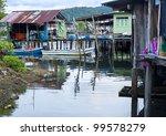 Traditional thai fishermans village - stock photo