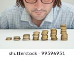 Business investments. Businessman siting at the table and thinking about possible dollar investments. - stock photo