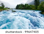 milky blue glacial water of... | Shutterstock . vector #99647405