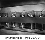 Row of women in public showers - stock photo