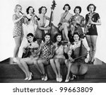 Group of young women playing instrument - stock photo