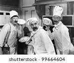 Three Chefs Holding Pies For A...