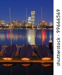 Docked boats against the cityscape of Back Bay Boston, Massachusetts, USA from across the Charles River. - stock photo