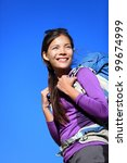 Hiker portrait. Woman hiking outdoors smiling happy and aspirational. Beautiful young mixed race Caucasian / Asian female model during hike travel. - stock photo