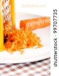 grater and fresh carrot macro shot suitable for restaurant menu - stock photo