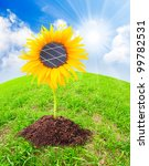 Solar panels on the sunflower. Environmental concept. Pure energy metaphor. - stock photo