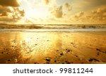 Sandy Beach At Golden Sunset
