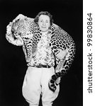 man posing with a leopard...
