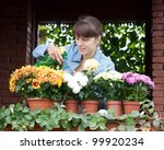 Female Gardener Caring For...