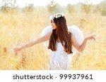 angel ethnic woman in golden... | Shutterstock . vector #99937961