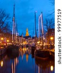 Old sailing ships and A-church in Groningen, Holland. - stock photo