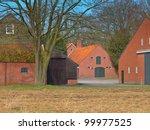 Traditional style facades of barns at a european farm - stock photo