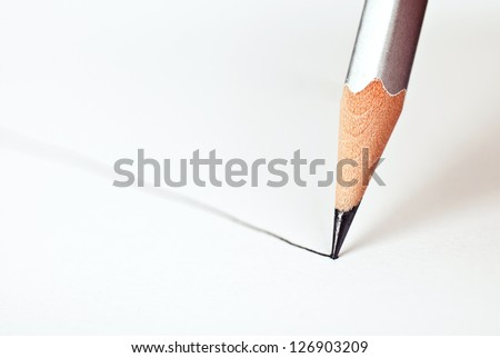 pencil draws a straight line on