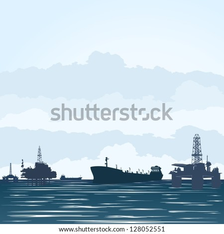 oil derricks at the ocean and