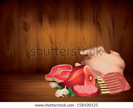meat and greens on wooden table