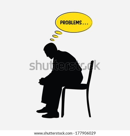 sad man sitting on chair