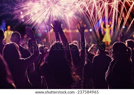 stock-photo-new-year-concept-cheering-crowd-and-fireworks