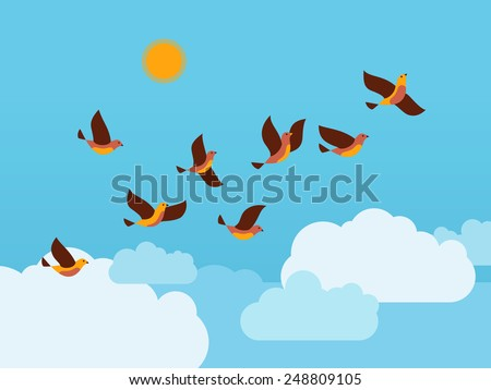 flock of birds flying in the