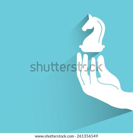 hand holding chess knight