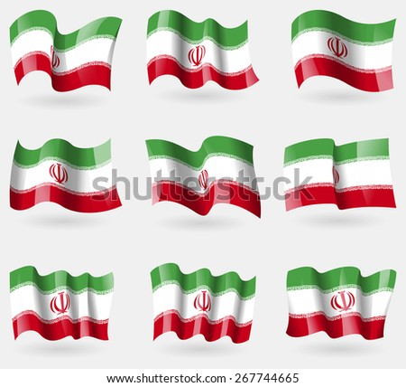 set of iran flags in the air