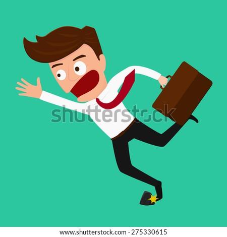businessman stumbling  on rock